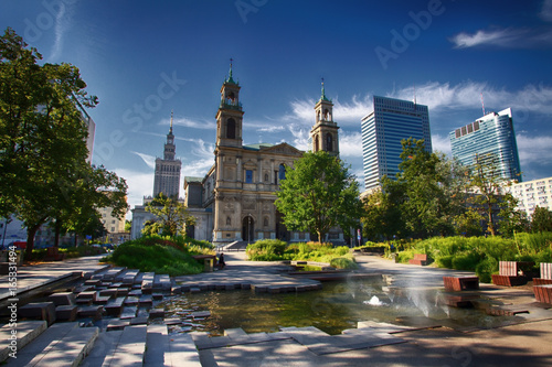 Fototapeta Grzybowski Square in Warsaw in a new view with an interesting fountain, the church of the Holy Spirit and Palace of Culture and Science