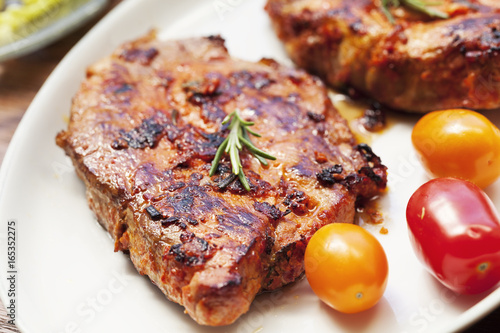 Barbecue pork loin chop and tomatoes