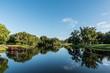 Fishing Dock on Reflective Neighborhood Pond Tampa Florida  2