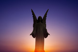 Beautiful angel in heaven over bright sunset - 165366278