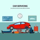 Auto repair shop workers behind repair of a car.