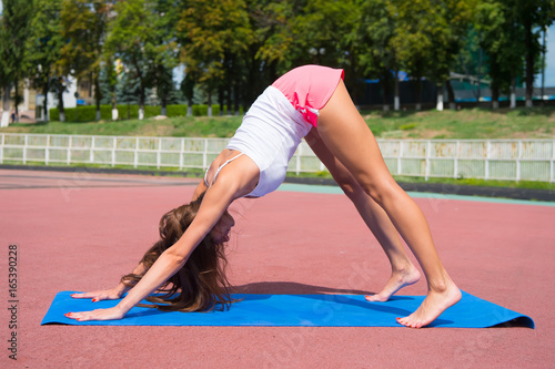 yoga pose of woman training on fitness mat