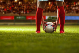 Fototapeta Sport - Soccer player with red socks preparing for free kick. © zeremskimilan