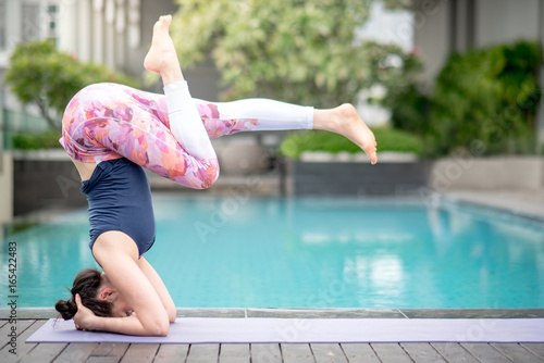 Sticker Young Asian woman doing yoga exercise