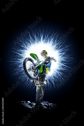 Professional dirt bike rider isolated on black background Poster