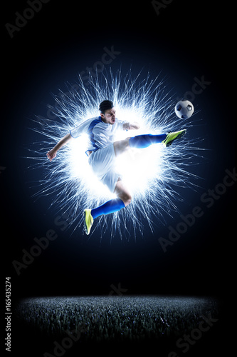 Professional football soccer player in action isolated on black