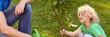 Quadro Smiling boy holding tree seedling