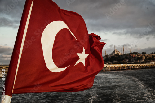 View of Turkish flag and blurred Istanbul background, vintage filter applied Poster