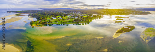 Aerial panorama of Mallacoota town and coastline at beautiful sunset