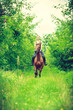 Young woman ridding on a horse - 165461632