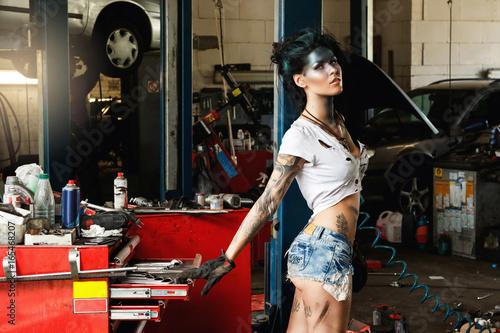 Woman mechanic in the garage