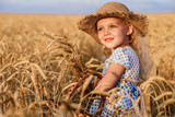 Happy child in autumn wheat field - 165483090