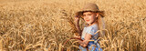 Happy child in autumn wheat field - 165484220