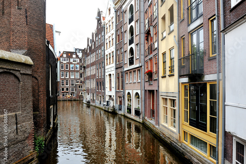 Amsterdam, Holland, Europe - scenic view of the canal and buildings Poster