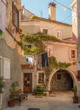 Old houses and archway in Cres - 165501882