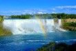 View of the American side of Niagara Falls with beautiful rainbow