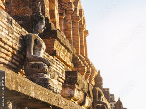 Buddha statue on temple wall in Sukhothai Historical Park World heritage Thailand