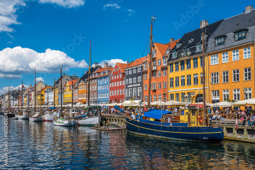 Nyhavn district is one of the most famous landmarks in Copenhagen, Denmark Poster