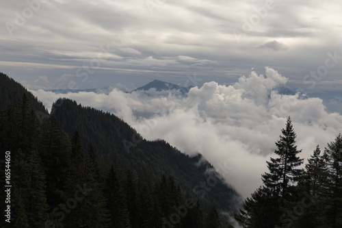 View of a cloudy valley in the Swiss Alps during the European summer