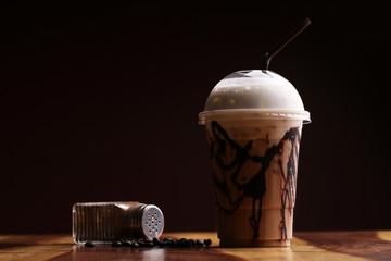 ice coffee on wood floor , Mocha