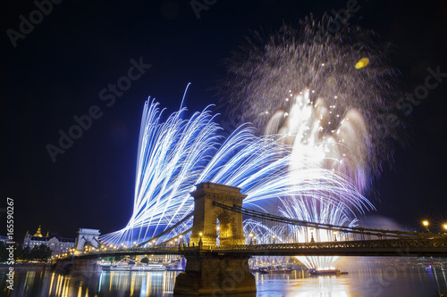 Fireworks in the night sky of Budapest. View of the illuminated Chain Bridge