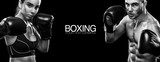 Two sportsmans boxers on black background. Copy Space. Sport concept. - 165604824
