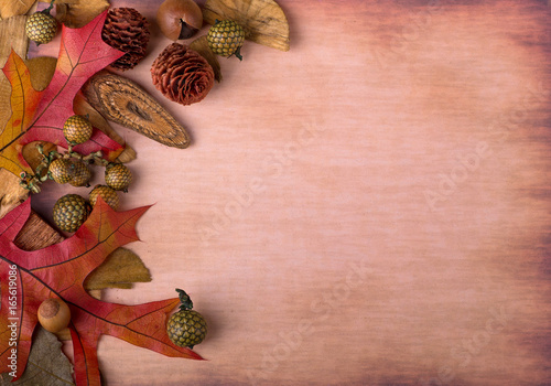 Colorful Autumn Decorations on a Vintage Colored Surface