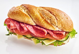 Fresh sandwich with salami, cheese and vegetables