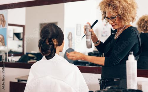 Professional hairdresser at work in salon © Jacob Lund