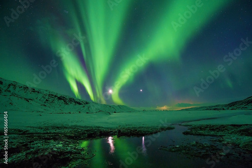 Foto op Plexiglas Landschappen Snowy Mountains at night with northern lights