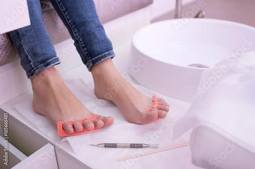 Papiers peints Pedicure Step for applying gel polish in pedicure. Manicure professional tools. Beauty spa procedure in salon