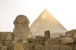 Ancient Egyptian Pyramid of Khafre Giza and Great Sphinx. Natural evening light, no colour saturation.
