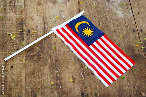 Spoed canvasdoek 2cm dik Kuala Lumpur Independence Day concept - Malaysian Flag Over Wooden Background