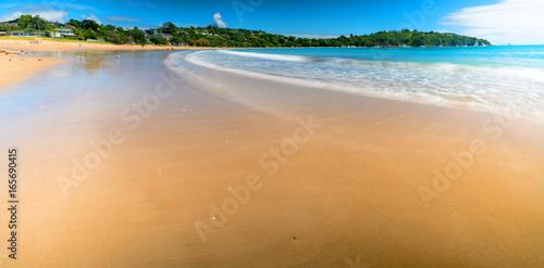Panorama of sand beach and blue sea