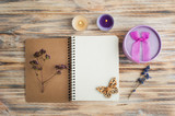 Notebook, lavender flowers, candles, butterfly