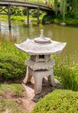 Japanese style stone lantern in the Japanese Garden at Chicago Botanic Garden, Illinois, USA