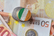 euro coin with national flag of ireland on the euro money banknotes background. - 165737008