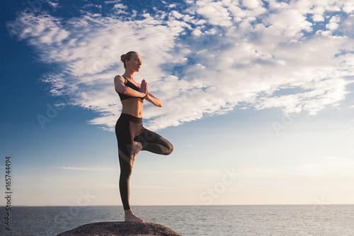 Obraz na płótnie caucasian fitness woman practicing yoga