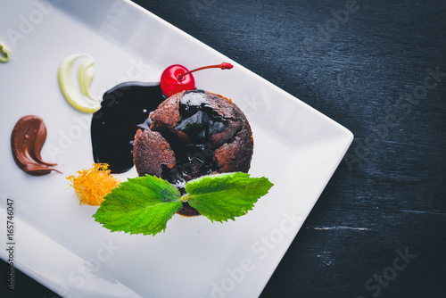 Chocolate Fund. On a wooden background. Top view. Free space for your text. - 165746047