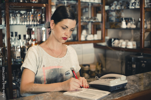 Foto op Canvas Pizzeria Young woman working at the pizzeria and writing order