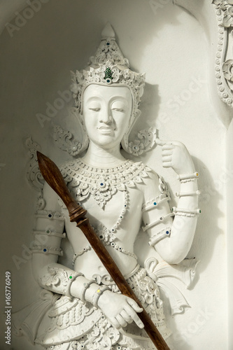 White statue at Buddhist temple in Thailand Poster