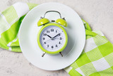 Alarm clock with bells on the plate, lunch time concept, top view with copy space - 165780062