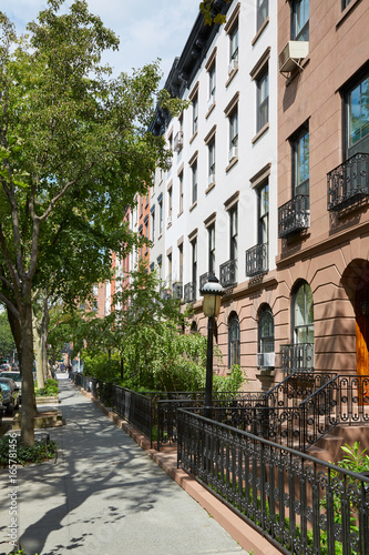 Townhouse buildings in New York in a sunny day Poster