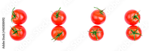 Set of fresh tomatoes, isolated on a white background, top view. A group of red tomatoes with green leaves for summer salad. Juicy and ripe tomatoes from the garden.