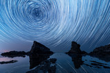 Star trails over the rock phenomenon The Ships - 165809438