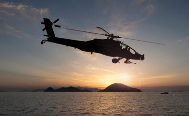 attack helicopter on the sun set