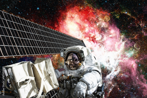 Deurstickers Heelal Astronaut in outer space. Spacewalk. Elements of this image furnished by NASA