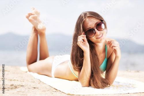 girl sunbathing on a beach