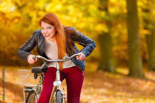 Fashionable girl with bike.