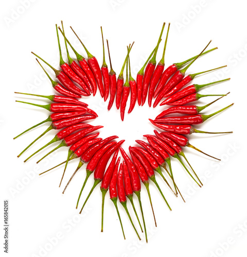 Deurstickers Hot chili peppers Herz aus Chilischoten